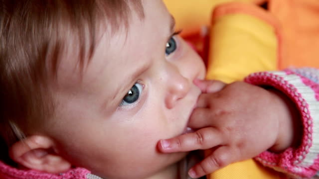Close-up of a baby sucking fingers video