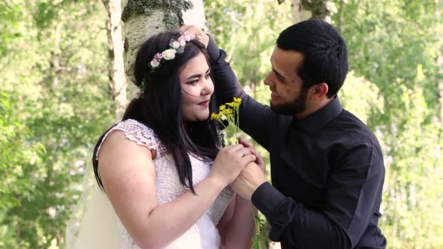 close-up of a bride showing affection for the groom. - young couple wedding friends video stock e b–roll