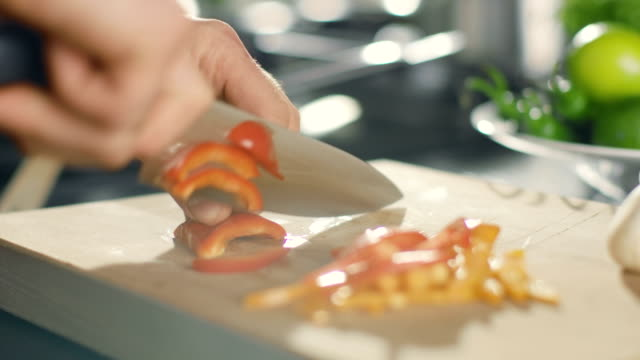 Close-up of a Chef Masterfully Cutting Colorful Vegetables on Cutting Board. Tomatoes and Mushrooms. video