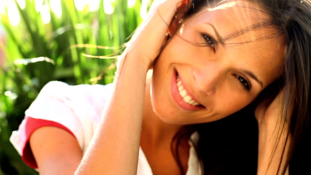 Closeup of a cute female with hands in hair Portrait of a cute young female with her hand in hair brown hair stock videos & royalty-free footage