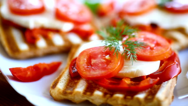 Closeup of a fresh sandwich with mozzarella, tomatoes video