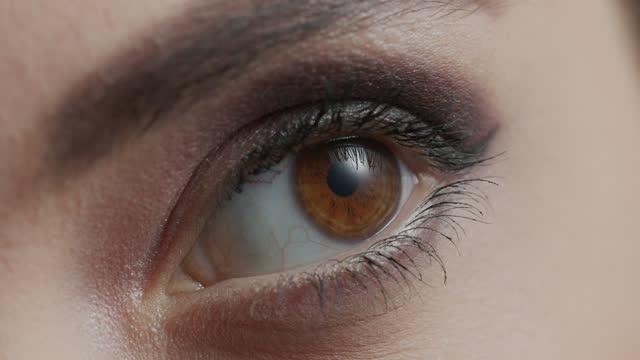 Close-up of a girl eye with smoky make-up opens. video