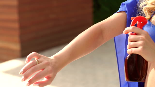 close-up of a girl sprays on your hands sun balm. - sun cream stock videos & royalty-free footage