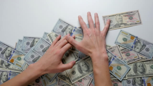close-up of a hand take out dollar bills. the concept of winning money - bonus video stock e b–roll