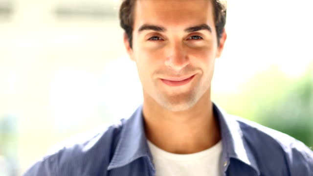 Close-up of a handsome young man smiling video