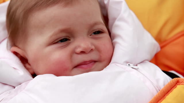Close-up of a happy baby girl looking at camera video