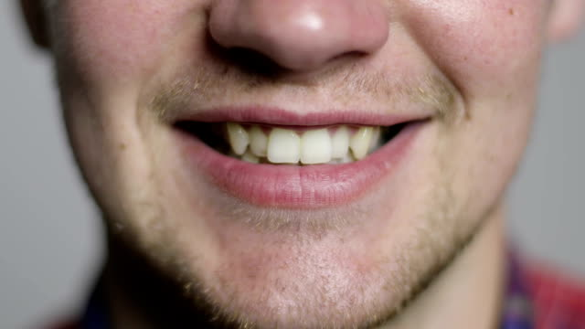 Close-up of a male mouth with crooked teeth. video