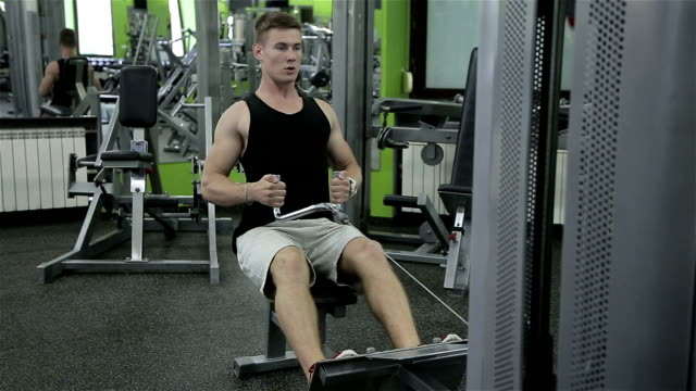 Close-up of a man performs gym exercises video
