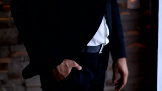 close-up of a man's hand in his suit pocket - prom fashion stock videos and b-roll footage