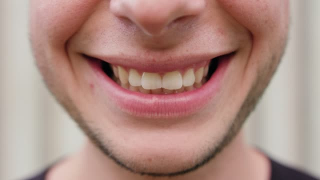 close-up of a men's mouth smiling - рот стоковые видео и кадры b-roll