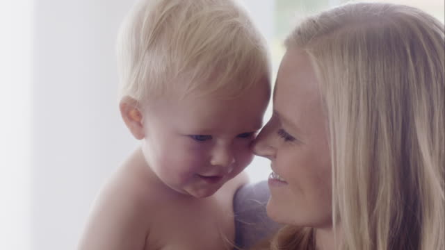Close-up Of A Mother Loving Her Baby Boy video