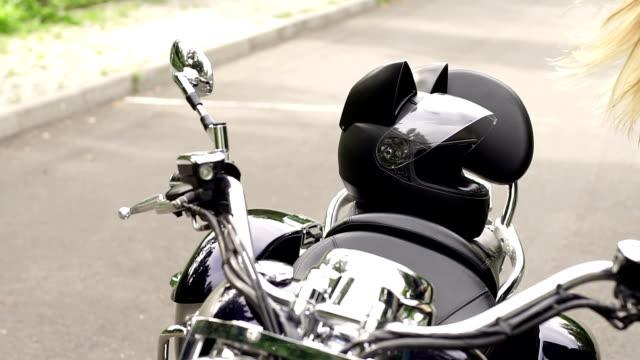 vídeos de stock e filmes b-roll de closeup of a motorcycle and a helmet with cat ears - helmet motorbike