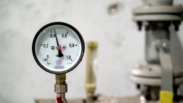 Closeup of a pressure meter on a machine video