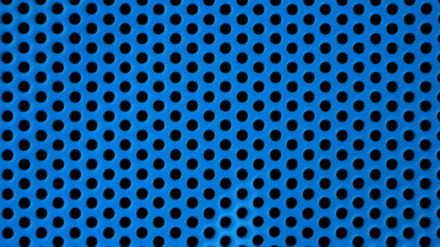 Close-up of a rotating blue Speaker audio equipment, 4k Resolution.