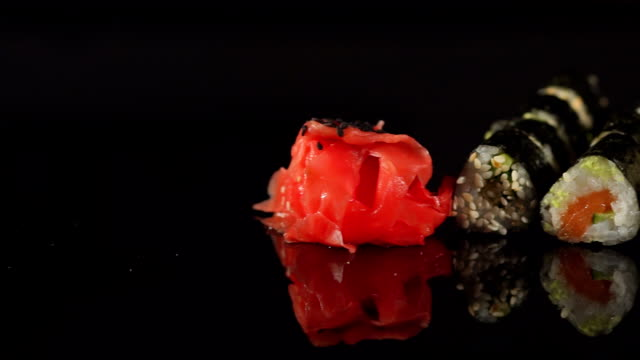 Close-up of a row of sushi on a black background. video
