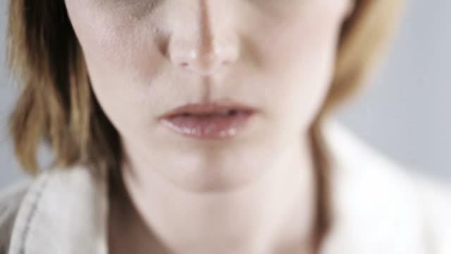 close-up of a sad/nervous woman; hd photo jpeg - 25 29 år bildbanksvideor och videomaterial från bakom kulisserna