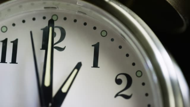 Close-Up of a Silver-Colored, Metal, Retro-Style, Analog Alarm Clock Almost Striking 1:00