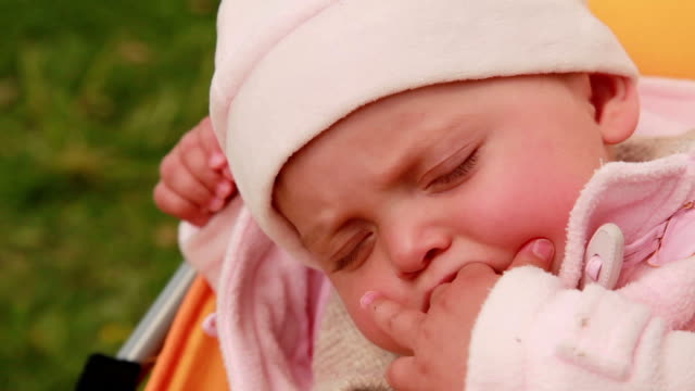 Close-up of a sleeping baby in the pram video