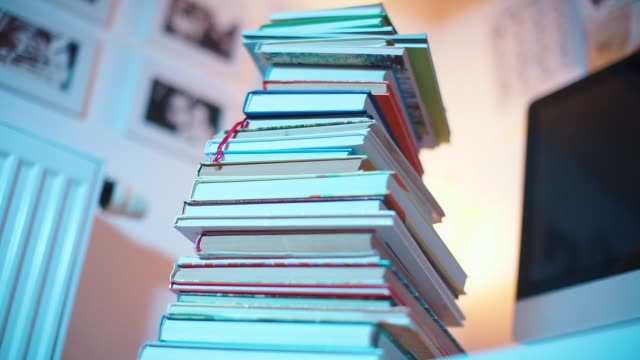 close-up of a stack of books in a library close-up of a stack of books in a library, books lie one on one textbook stock videos & royalty-free footage