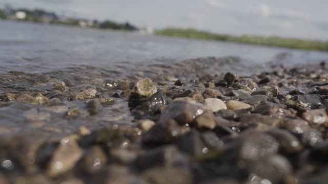 Photo of Closeup of a stony beach at evening