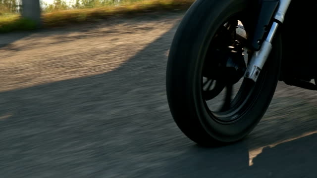 closeup of a wheel of the motorcycle in motion,which goes to the motorcyclist on the highway closeup of a wheel of the motorcycle in motion,which goes to the motorcyclist on the highway FullHD power supply stock videos & royalty-free footage