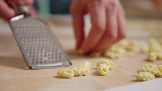 Close-up of a woman preparing pasta