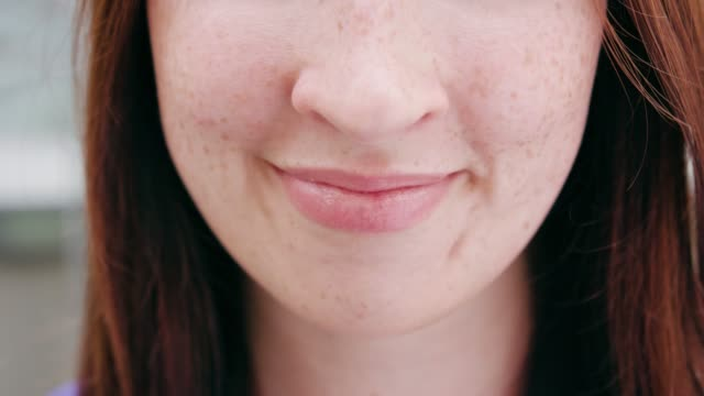 close-up of a women's mouth smiling - рот стоковые видео и кадры b-roll