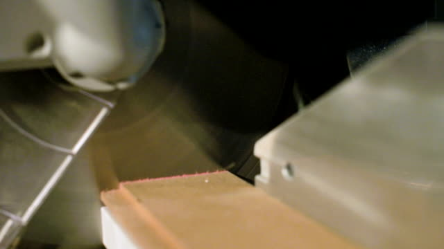 Close-up of a work on a machine with a circular saw. Cutting wooden billet circular machine in slow motion Close-up of a work on a machine with a circular saw. Cutting wooden billet circular machine in slow motion. handbook stock videos & royalty-free footage
