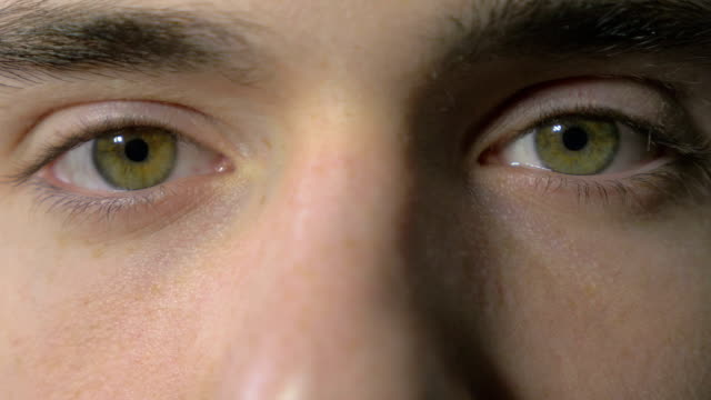 Close-up of a young man eyes opening and blinking Close-up of a young man eyes opening and blinking close to stock videos & royalty-free footage