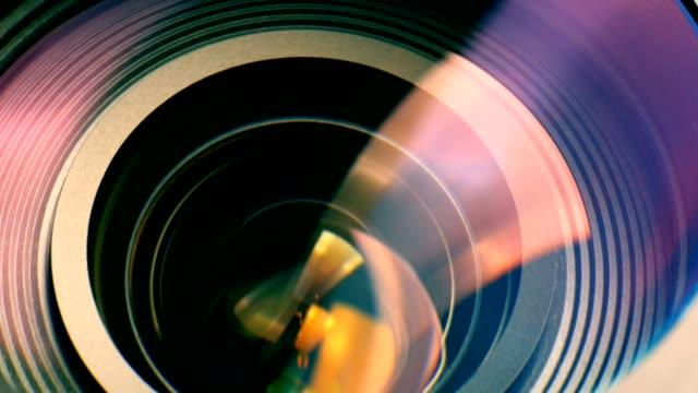 Closeup of a zooming camera lens video