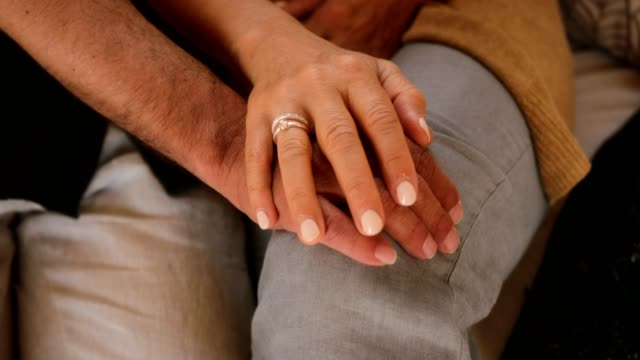 close-up of affectionate senior married couple's hands - married stock videos & royalty-free footage