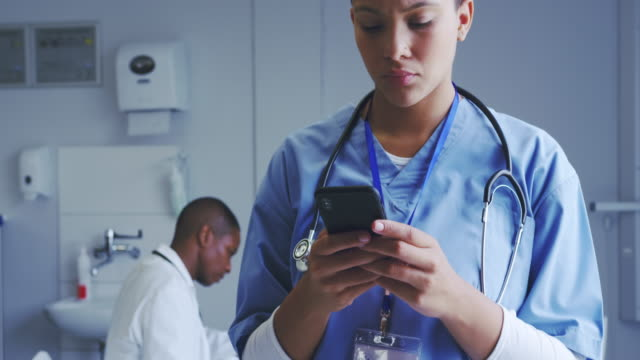 Close-up of African American female doctor using mobile phone in hospital 4k