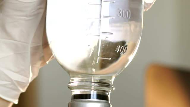 Close-up of air bubbles in the bottle drug. video