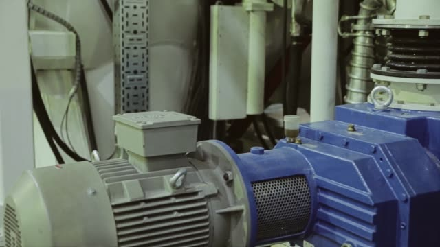 Close-up of an electric motor on a large industrial installation. Industrial premises