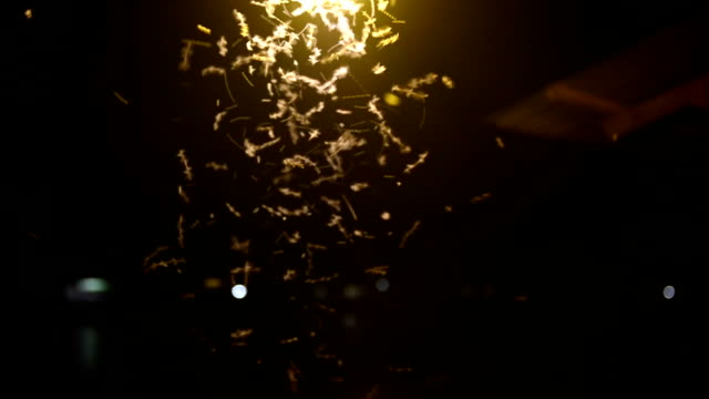 Close-up of an old street lamp with insects at night video