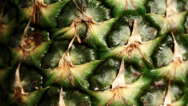 Closeup of ananas fruit rotating video