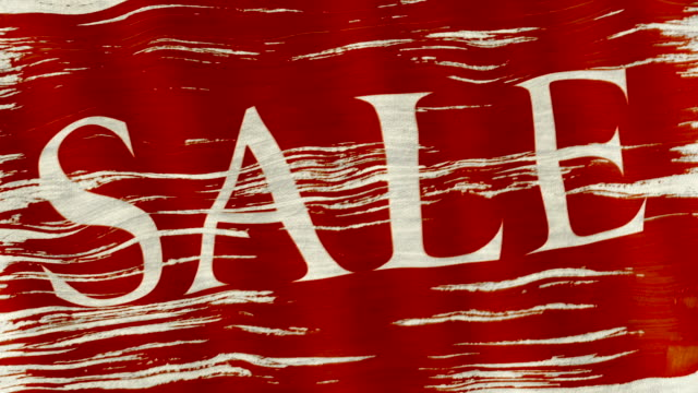 Closeup of art brush watercolor painting of red flag  with white word sale blown in the wind. video