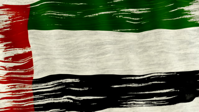Closeup of art brush watercolor painting UAE flag blown in the wind. video