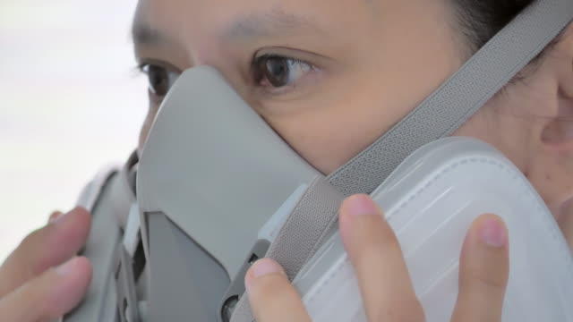 Close-up of Asian women health care staff wearing a protective face mask of confidence to prevent epidemics of Coronavirus or Covid-19 ,Leadership,Medical,Healthcare And Medicine,Social distancing, Women in STEM,Pandemic threat,Covid19,Volunteer video