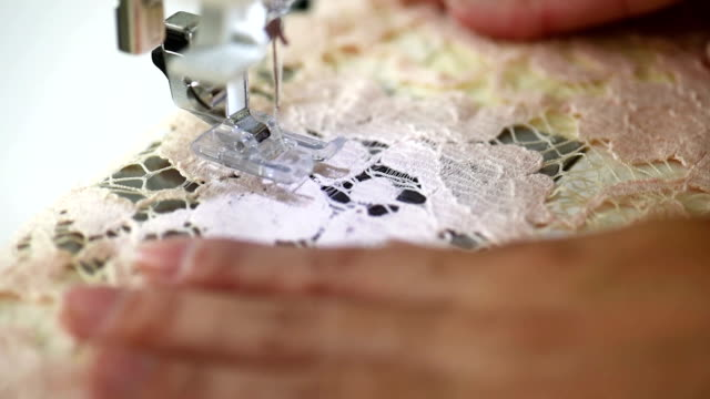 Closeup of automatic sewing machine video