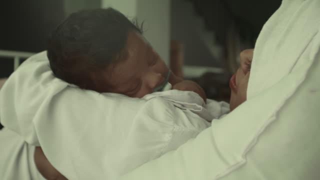 close-up of baby sleeping - tułów filmów i materiałów b-roll