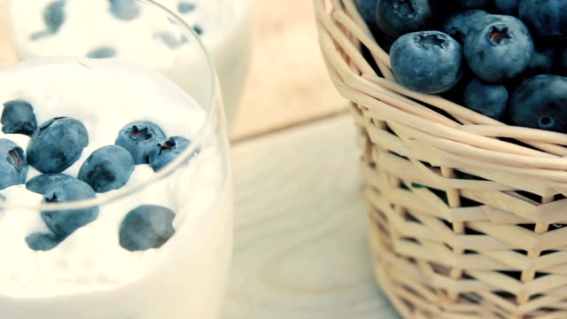 Close-up of basket with blueberries and milkshake video
