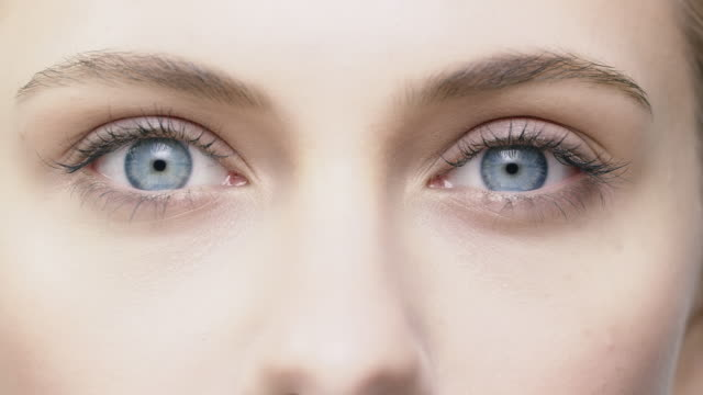 Close-up of beautiful woman opening her blue eyes Beautiful woman opening her blue eyes. Close-up shaky shot of young female is staring. She is having natural beauty. eyes closed videos stock videos & royalty-free footage
