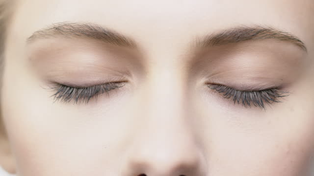 Close-up of beautiful woman with closed eyes