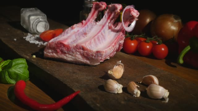 Close-up of beef ribs and ingredients on the board video