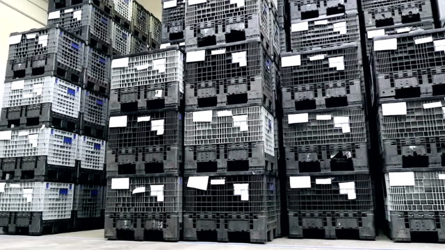 Close-up of black plastic crates in warehouse video
