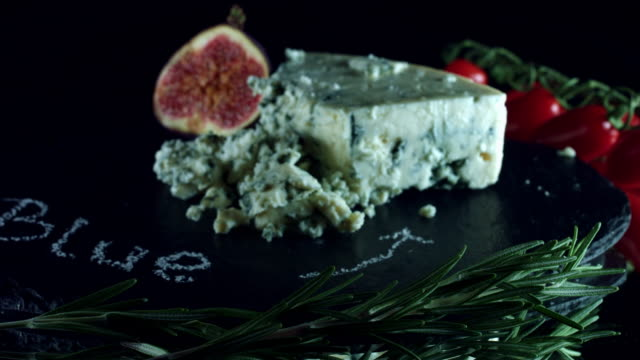 4K Close-up of Blue Cheese with Herbs and Figs video