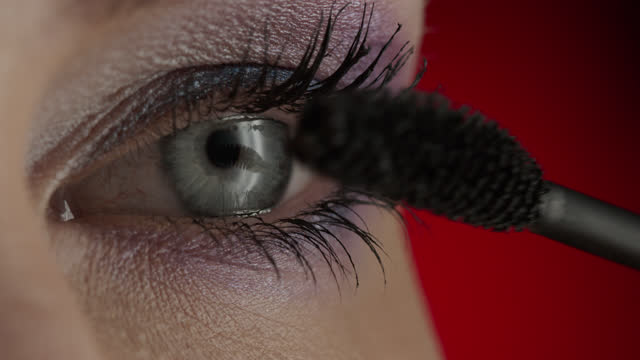Close-up of blue eyes and eyelashes of a girl applying mascara. Close-up of blue eyes and eyelashes of a girl applying mascara. 4K 30fps ProRes 4444 mascara stock videos & royalty-free footage