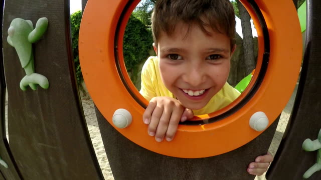 close-up of boy's face looks out the window - slitta video stock e b–roll