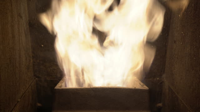 close-up of burning fire in modern economical pellet stove at home, alternative biofuel for heating houses. industrial production, power and energy concept - биомасса возобновляемая энергия стоковые видео и кадры b-roll